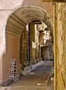 Narrow alley with decorated tunnel, in Pyrgi  medieval village, Chios island, Greece Royalty Free Stock Photo