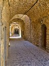 Narrow alley at the medieval castle village of Mesta in Chios island , Greece Royalty Free Stock Photo
