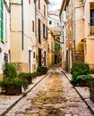 Narrow alley in mediterranean old village Royalty Free Stock Photo