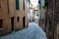 Narrow Alley With Old Buildings In Medieval Town Stock Image