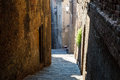 Narrow Alley With Old Buildings In Medieval Town Stock Photos