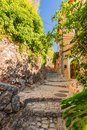 Spain Majorca, alley in old mediterranean village Fornalutx Royalty Free Stock Photo