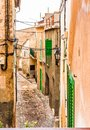 Narrow alley in old mediterranean village Royalty Free Stock Photo