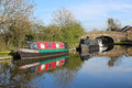 Narrow boats moored on lancaster canal at garstang looking from the towpath along the in lancashire england to two the far side of Stock Photos