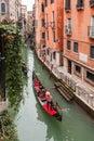 Narrow canal with gondola in venice ride on italy Stock Photos