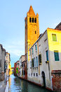 Narrow canal and old bell tower in venice italy Royalty Free Stock Photos
