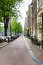 Narrow Cobbled Street in Amsterdam City Centre Royalty Free Stock Photo