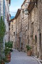 street with flowers in the old village Tourrettes-sur-Loup , France. Royalty Free Stock Photo