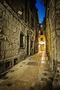 Narrow cobbled street in old town at night, France. Royalty Free Stock Photo