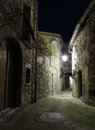 Narrow cobbled street in old town Peille at night. Royalty Free Stock Photo
