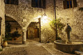 Narrow cobbled street in old town Peille at night, Royalty Free Stock Photo