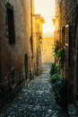 Narrow cobbled street in old village France. Royalty Free Stock Photo