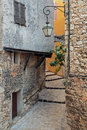 Narrow cobbled street in the old village France. Royalty Free Stock Photo
