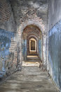 Narrow corridor in old fortress basement Royalty Free Stock Photo