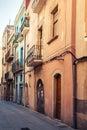 Narrow empty street view of tarragona vintage stylized photo with tonal correction filter effect Stock Photo