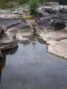 Narrow end little waterhole between rocks with escape Stock Image