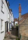 Narrow english lane old houses and street in robin hood s bay small coastal town in yorkshire england Royalty Free Stock Photos