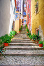 Narrow european street with cobblestone steps and old houses, Po Royalty Free Stock Photo