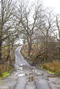 Narrow farm lane a is an entrance to a walk in the national park in the brecon beacons in wales after weeks of rain the land is Royalty Free Stock Photos