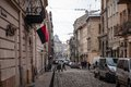 Narrow Lviv street with combat Ukrainian flag Royalty Free Stock Photo