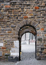 Narrow medieval gate Stock Photo