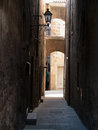 Narrow medieval street of the ancient italian town Stock Photos