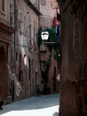 Narrow medieval street of the ancient italian town Royalty Free Stock Photos