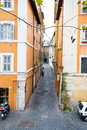 Narrow medieval street in rome old city of italy Stock Images