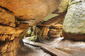 Narrow path in bledne skaly in gory stolowe polska poland among rock walls sudety mountains Royalty Free Stock Image