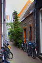 Narrow pedestrian street with bicycles in Amsterdam. The Netherl Royalty Free Stock Photo