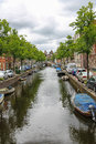 Narrow river channel in the city centre of Haarlem Royalty Free Stock Photo