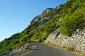 Narrow road on the slope stony Royalty Free Stock Photo