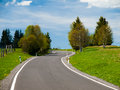 Narrow rural asphalt road in the mountains Royalty Free Stock Photo