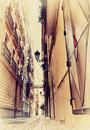 Narrow spanish street photo old image style Royalty Free Stock Images