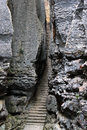 Narrow stairway in SShilin stone forest, world-famous natural karst area, China Royalty Free Stock Photo