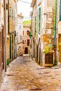 Narrow street alley in old mediterranean village Royalty Free Stock Photo