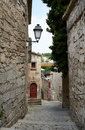 Narrow street in Baux village Stock Image