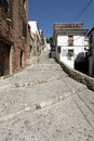 Narrow street in Granada, Spain Stock Images