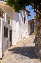 Narrow street in greek mountain village, island of Crete Stock Image
