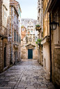 Narrow street inside dubrovnik old town with church on the end Stock Photos