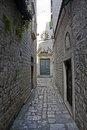 Narrow street leading to church stone the st peters in town of trogir dalmatia croatia Royalty Free Stock Photos