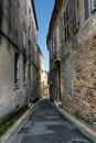 Narrow street in old city Royalty Free Stock Images