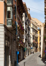 Narrow street in old european city. Alicante Royalty Free Stock Photo