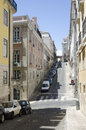 Narrow street in an old european city lisbon portugal Royalty Free Stock Images