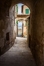 Narrow street in an old italian town tuscany italy a Royalty Free Stock Photography