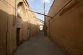 Narrow street of old part Yazd city. Royalty Free Stock Photo
