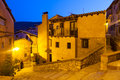 Narrow street of old spanish village in summer night albarracin aragon Stock Photos