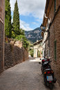 Narrow street old traditional houses village majorca island Royalty Free Stock Images