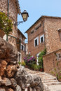 Narrow street old traditional houses village, Majorca island Royalty Free Stock Photo
