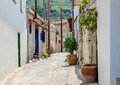 Narrow street in old village Stock Images